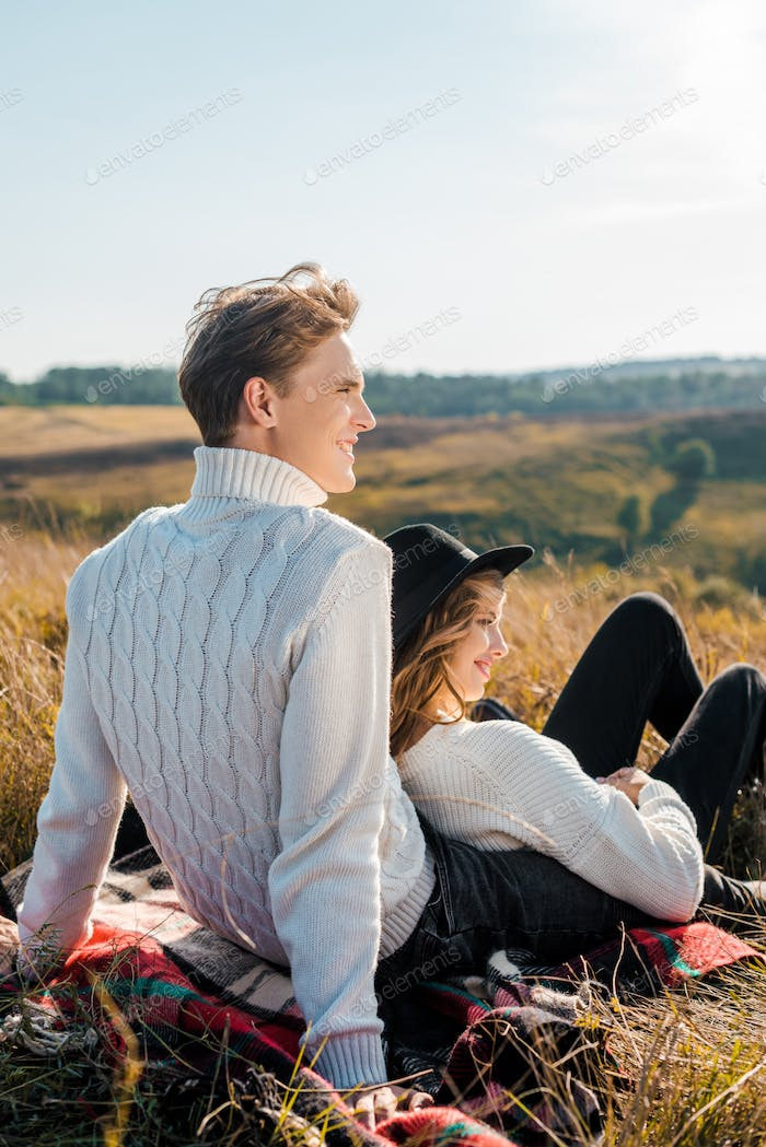 Young Couple Looking Away on Rural Meadow