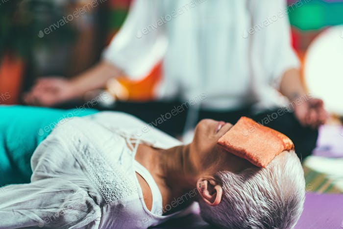 Senior woman on a guided meditation class