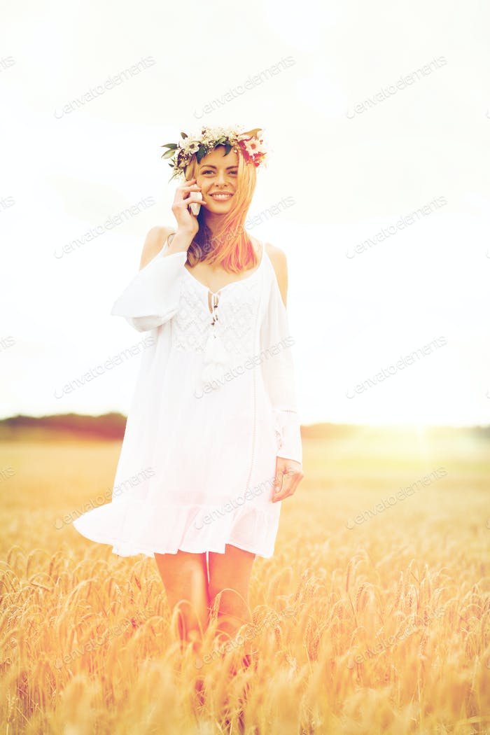 happy young woman calling on smartphone at country