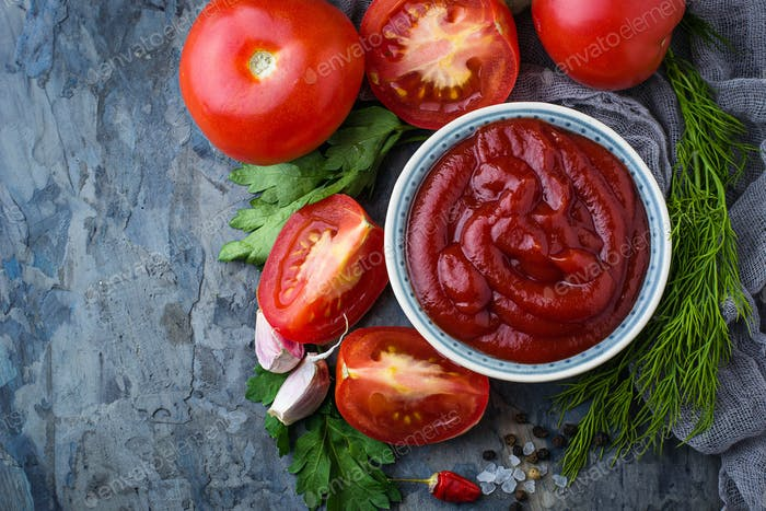 Tomato ketchup sauce on concrete background