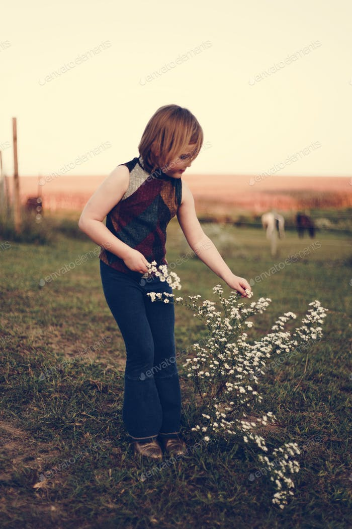 A young girl is having fun in the farm