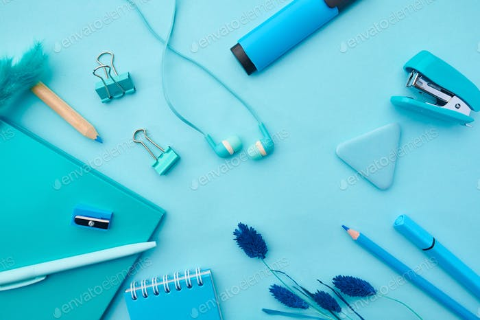 Office stationery supplies in blue tones