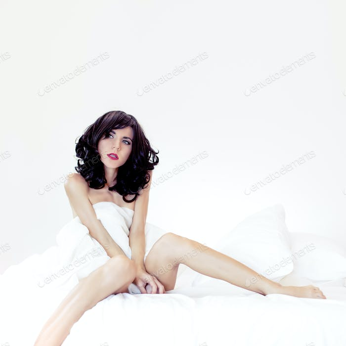 portrait of a sensual sexy girl in white bed