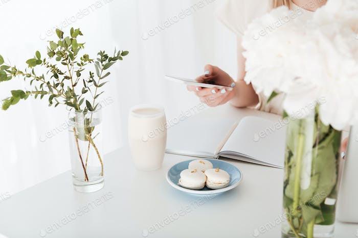 Cropped image of young woman sitting indoors make photo