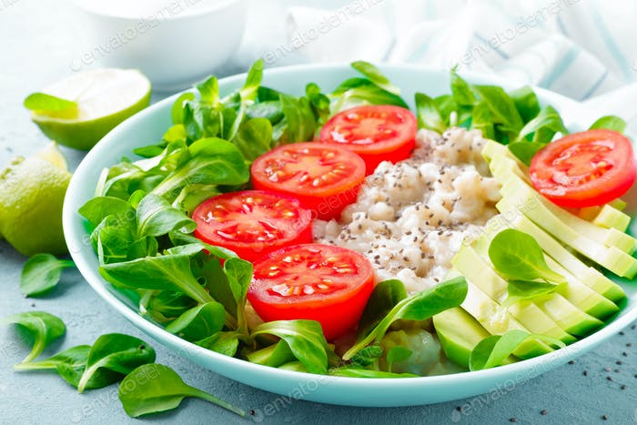 Oatmeal porridge with fresh vegetable salad