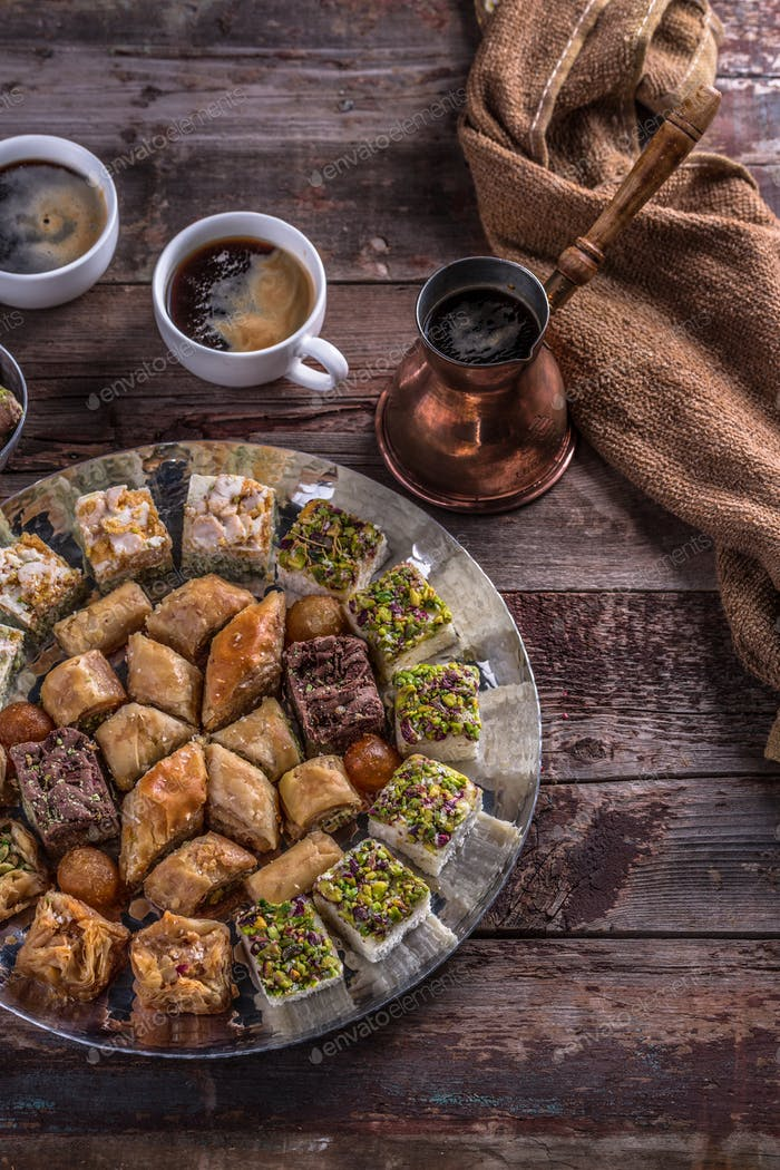 Coffee and Arabian baklava and delights, top view