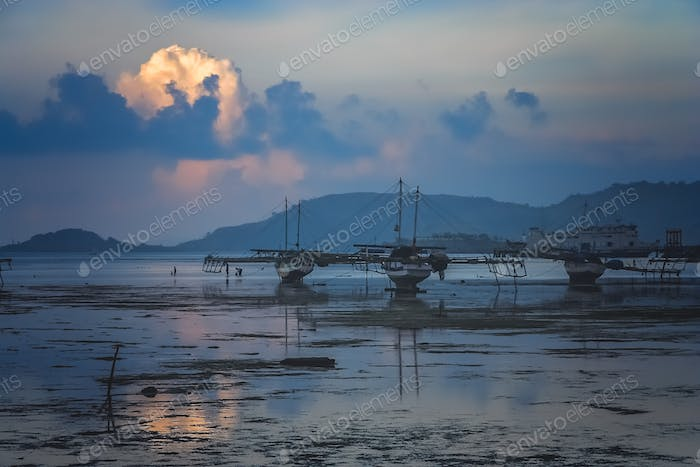 Moored boats after sunset in Sape village