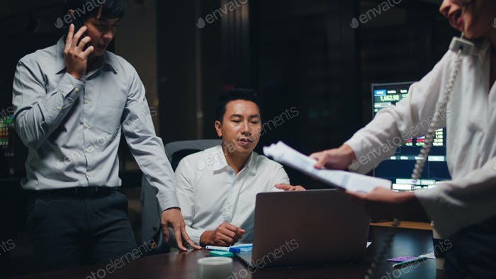 Collaborative process of multicultural businesspeople using laptop presentation