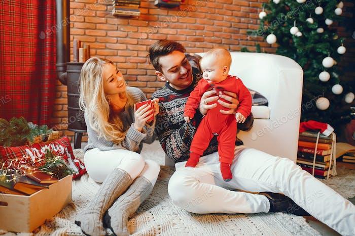 Family near Christmas tree