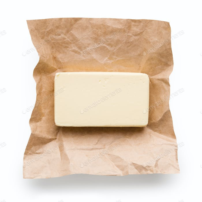 Piece of butter on white background