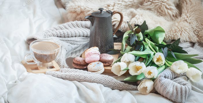 Still-life morning breakfast with coffee and macaroon