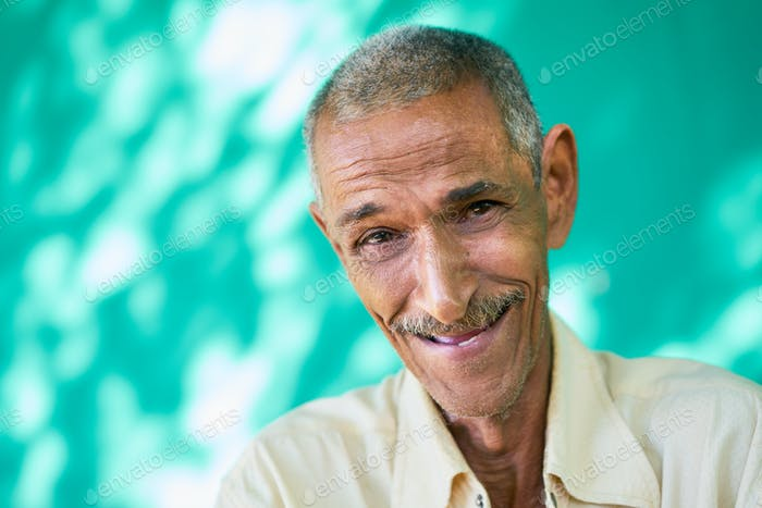 People Portrait Happy Elderly Hispanic Man Laughing At Camera