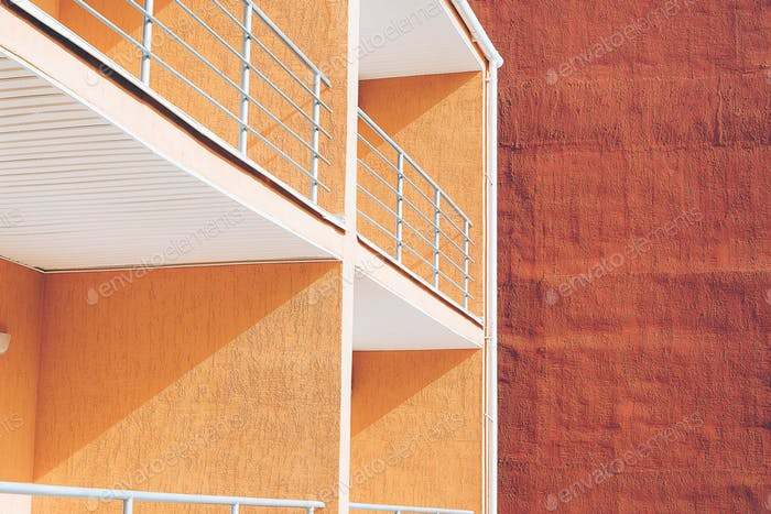 View of colorful orange buildings with balcony. Street photography