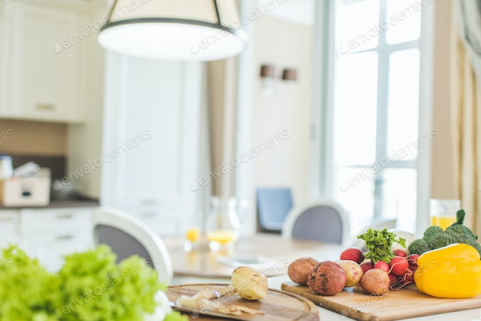 Vegetables and utensil on  kitchen  table