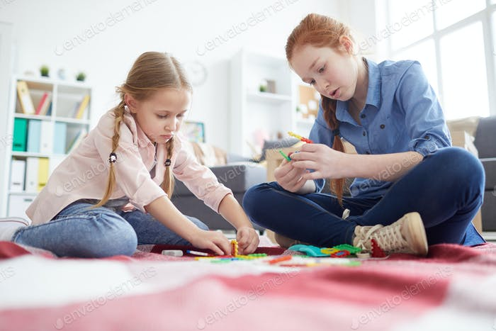 Two Girls Playing with Toys at Home