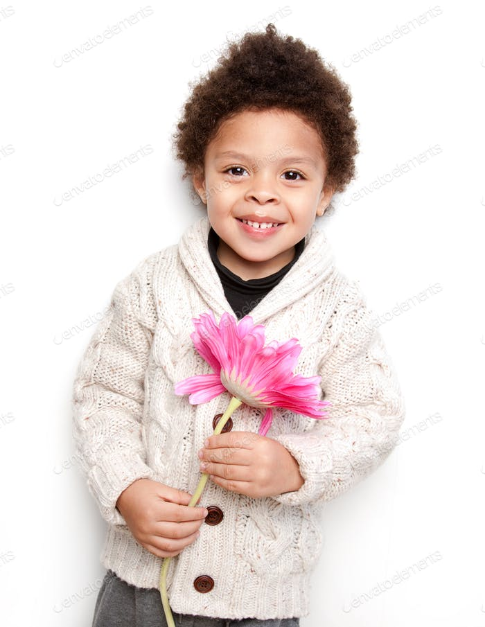 Cute child smiling with big pink flower