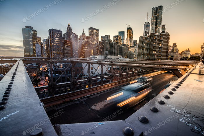 Manhattan wide angle view from the Brooklyn Bridge during Sunset