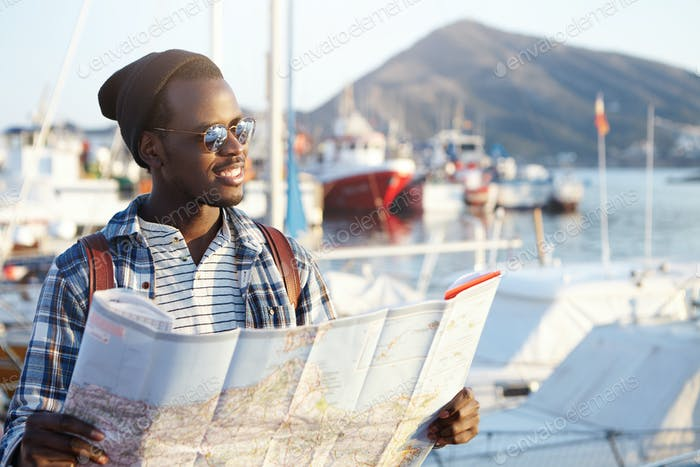 People, lifestyle, travel and tourism concept. Handsome fashionable young African American male tour