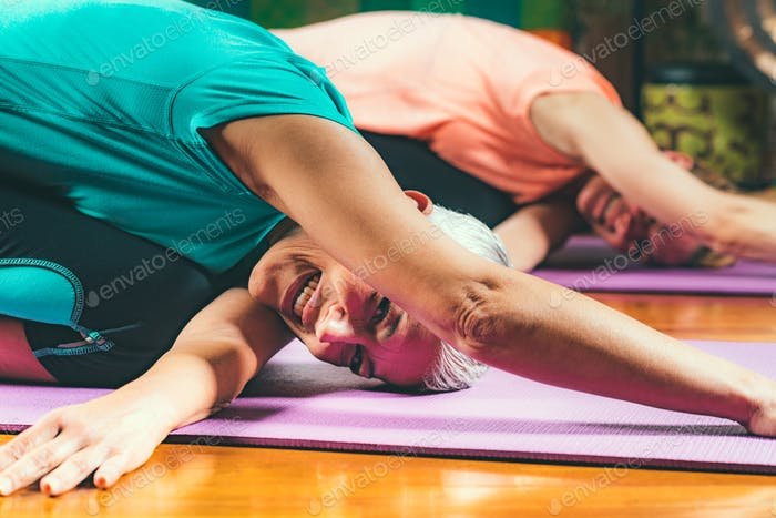 Senior woman on private yoga class