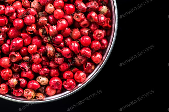 Red pepper seeds in pot with copy space