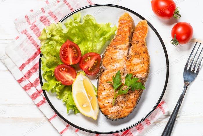 Grilled salmon fish steak on white