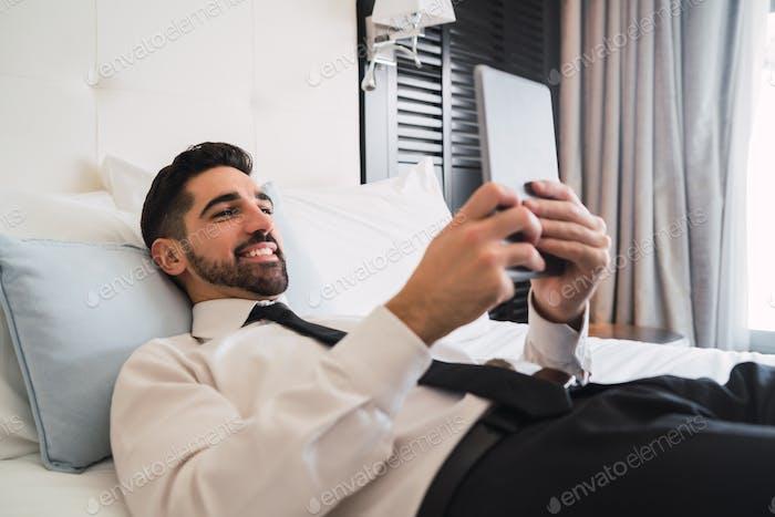 Businessman using his digital tablet.