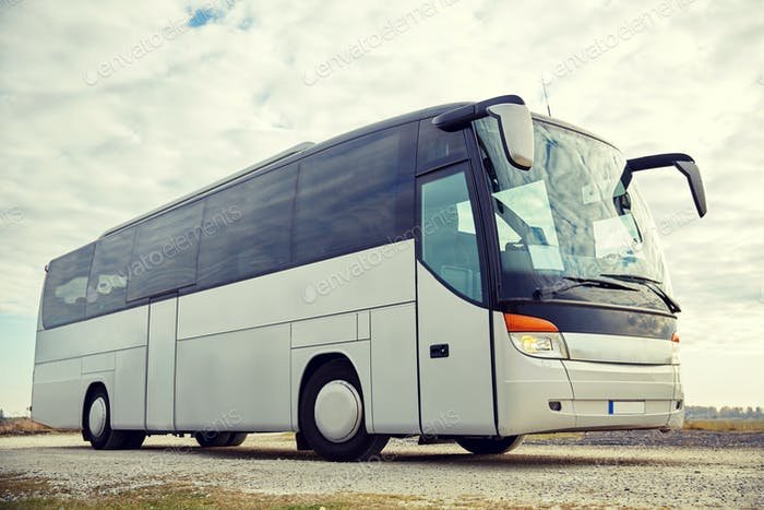 tour bus driving outdoors