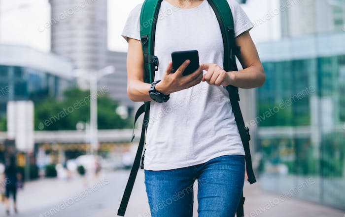 Woman use mobile phone walking on street