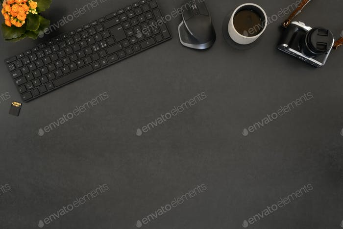 Overhead view of coffee and computer parts with camera on table