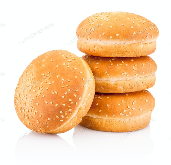 Four hamburger buns with sesame isolated on white background