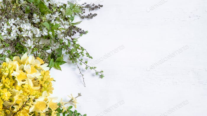 wooden light background with beautiful spring blooms.