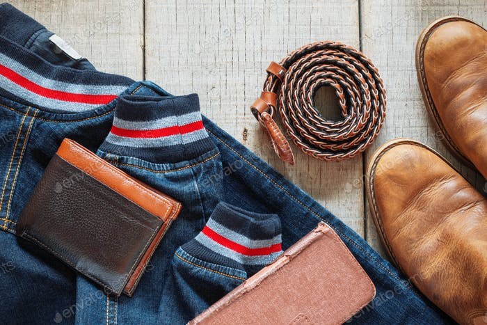 Denim and accessories on wooden