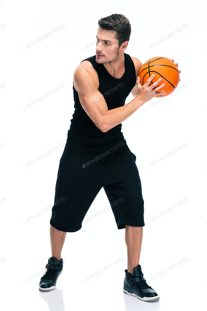 Handsome man im sports wear playing in basketball
