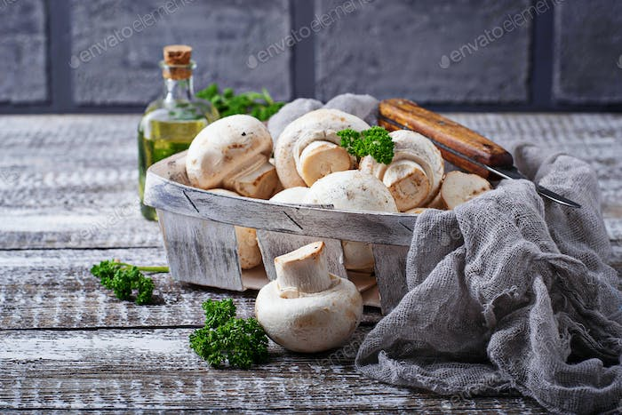 Raw fresh mushroom in basket