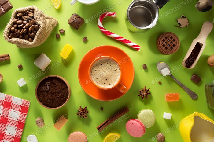 cup of coffee and ingredients at colorful background