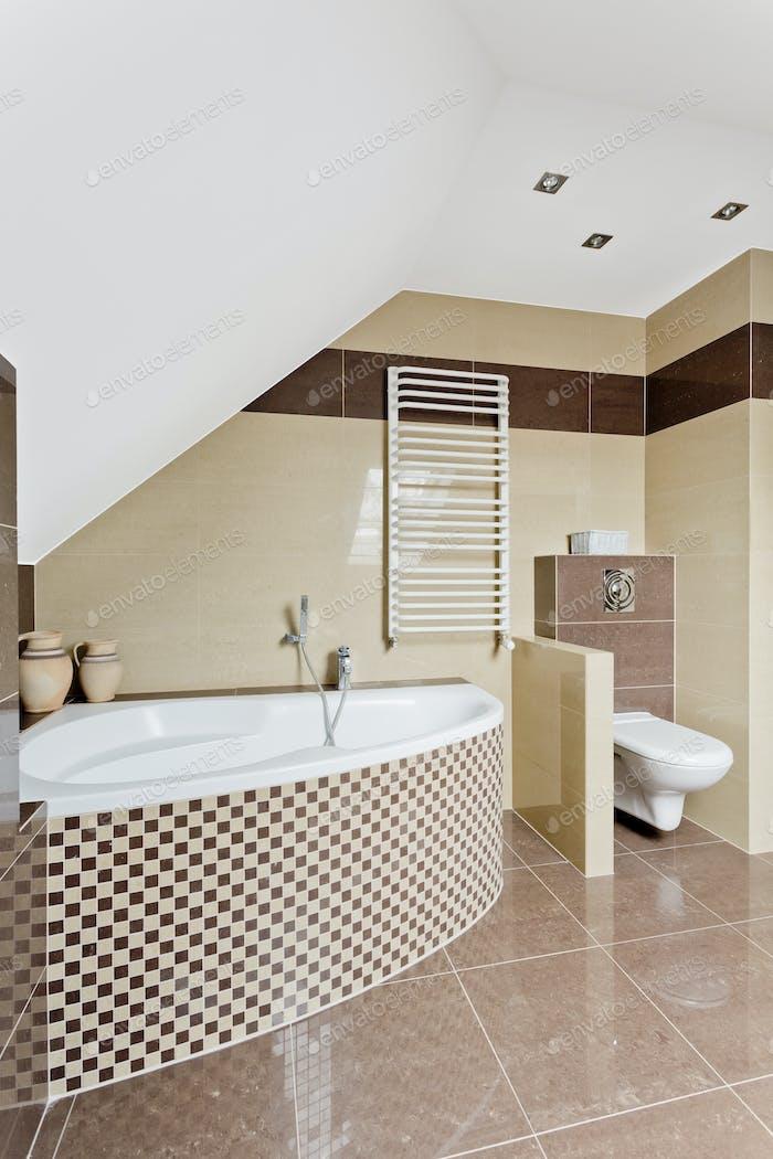 Bathroom with beige tiles