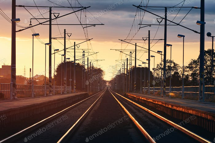 Railroad track at beautiful sunrise