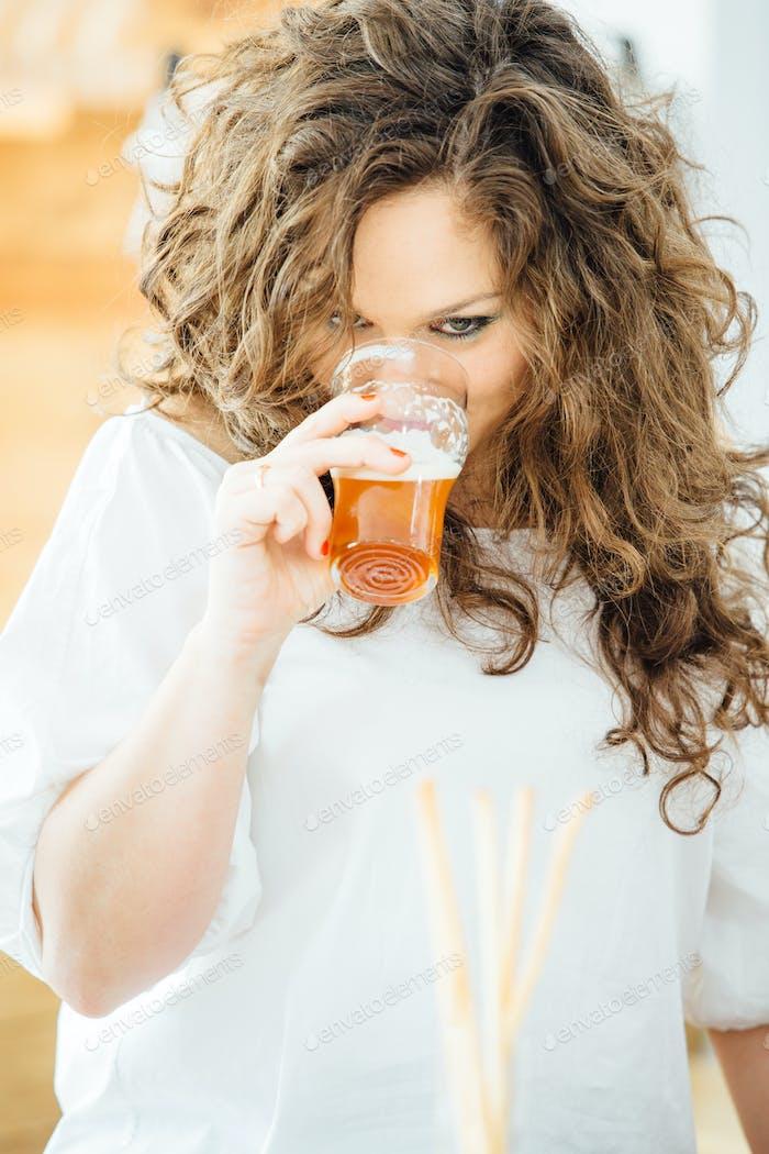 Woman drinking light craft beer