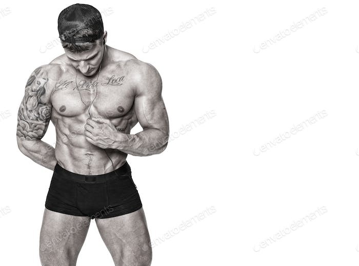 Handsome man with naked torso posing in studio