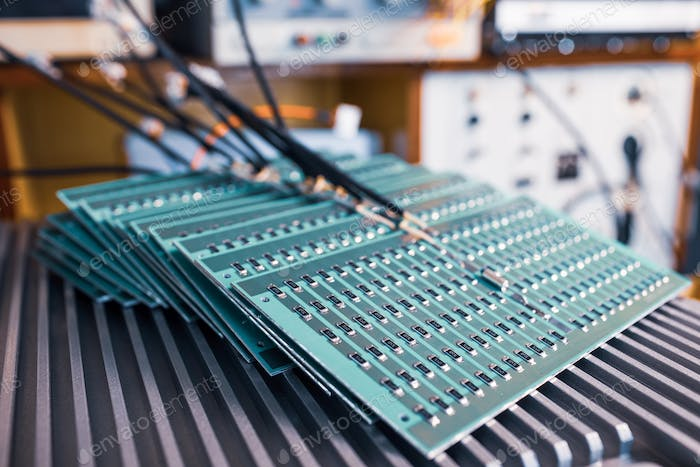 Microcircuits and components lie on metal plates