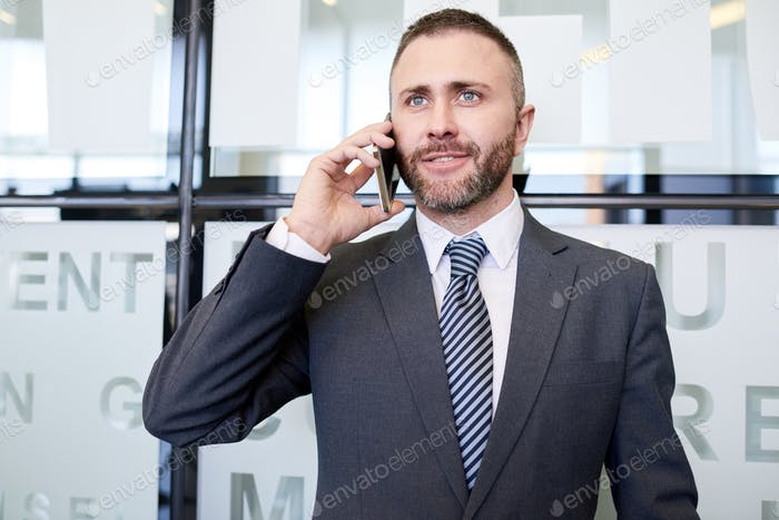 Mature Businessman Speaking by Smartphone