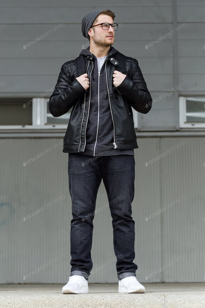 Modern young man posing in the street.
