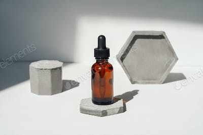 Front view of face serum with concrete.