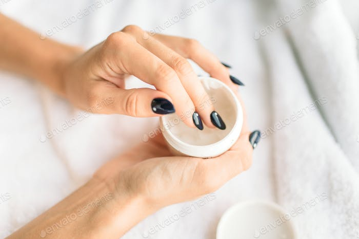Female person hands with beauty product closeup