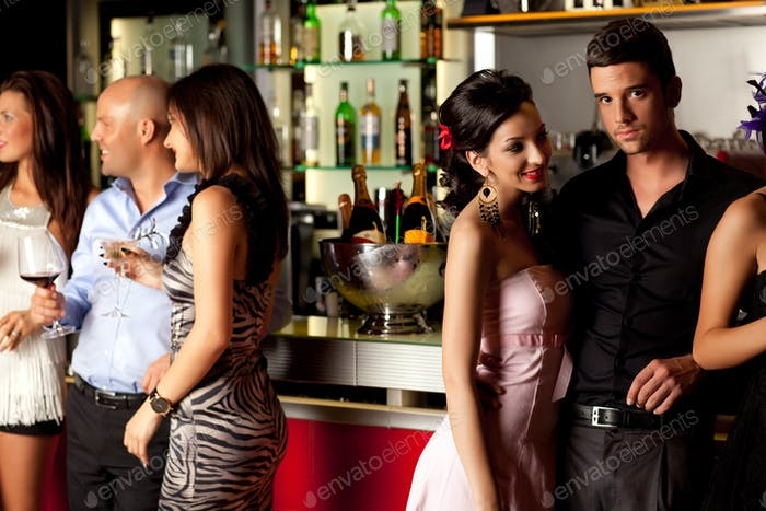 young people at bar counter