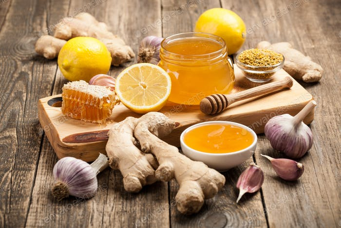 Healthy food table with honey, ginger, garlic and lemon