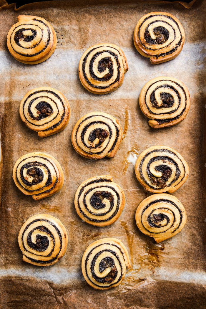Freshly baked homemade rolls and swirls on baking tray