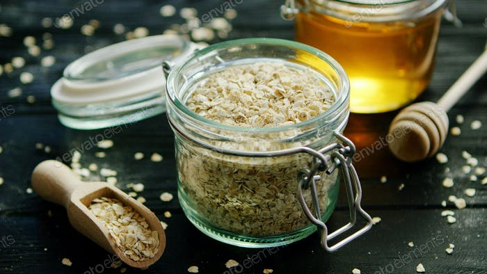 Oat and honey in glass jars
