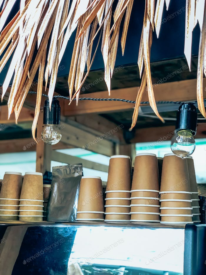 Disposable coffee cups in street market cafe