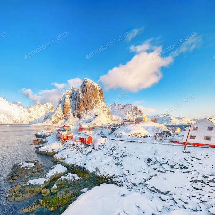 Fantastic winter view on Hamnoy village and Festhaeltinden mountain on background.